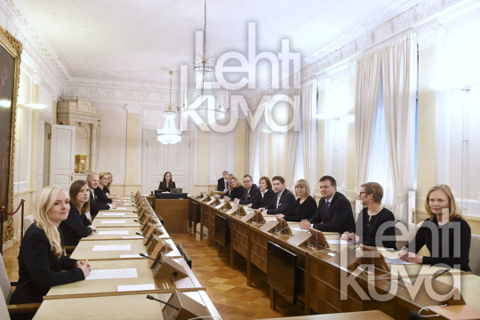 The new Prime Minister of Finland Sanna Marin (C) chairs her first government meeting